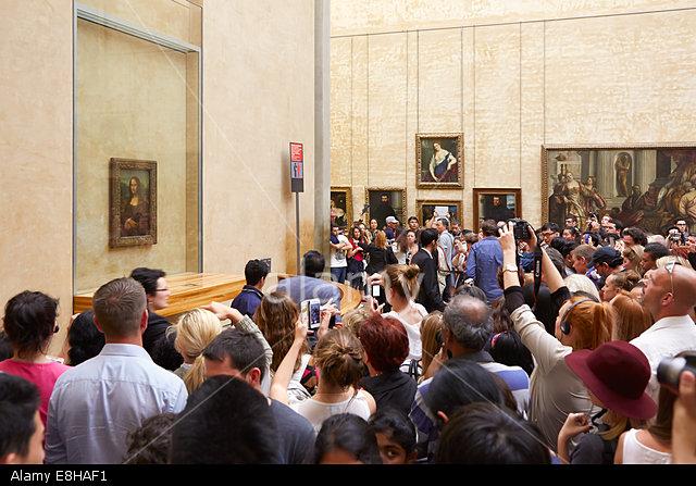 "E8HAF1 Tourists take photos of Leonardo Da Vinci ""Mona Lisa"" at the Louvre Museum"
